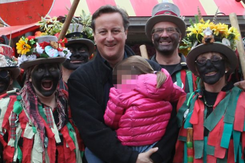 David Cameron with Morris dancers at Banbury Folk Festival, 2014.