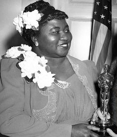 Hattie McDaniel winning the award for Best Supporting Actress, at the Academy Awards (1940)